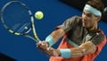Nadal eases past challenge of Monfils