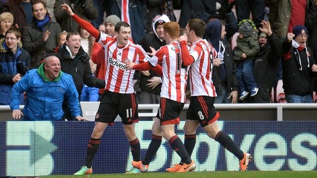 Adam Johnson (l) celebrates scoring Sundeland's equaliser with his team-mates