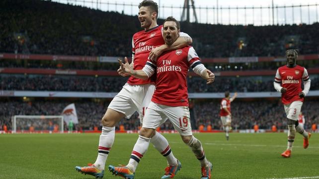 Arsenal's Santi Cazorla celebrates scoring the opening goal with team-mate Olivier Giroud (l)