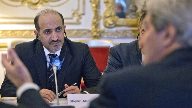 Ahmad al-Jarba said in Istanbul after his National Coalition group that it would attend Wednesday's peace conference in Switzerland