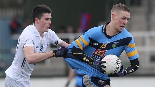 Kildare's Mick O'Grady (l) tackles Paul Mannion of UCD
