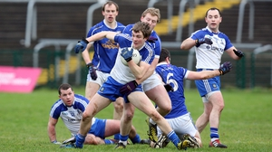 Monaghan's Jack McCarron battles with ball-holder James McEnroe of Cavan