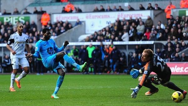 Emmanuel Adebayor rolls in Spurs third goal at Swansea
