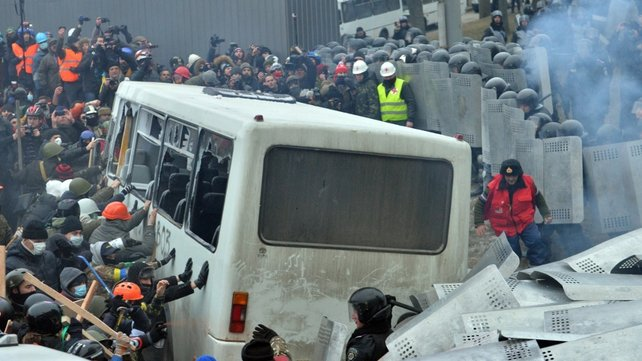 Protesters tried to overturn a bus commandeered by police to block the main road leading to parliament
