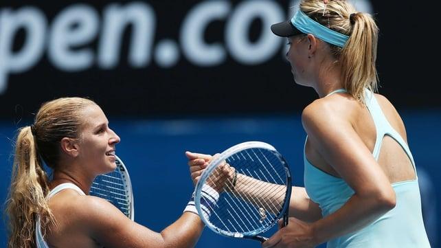 Dominika Cibulkova is congratulated by Maria Sharapova after the match