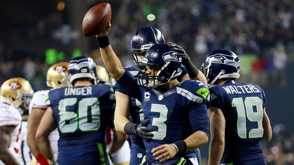 Quarterback Russell Wilson (3) of the Seattle Seahawks celebrates after seeing off the San Francisco 49ers
