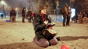 A protester prays as he holds an open Bible during the anti-government protest