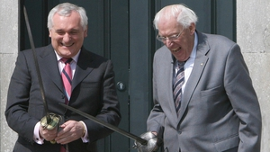 Mr Ahern and Mr Paisley brandish swords during the official opening of the Battle of the Boyne site
