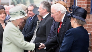 Britain's Queen Elizabeth II (L) meets Mr Paisley and his wife in March 2008