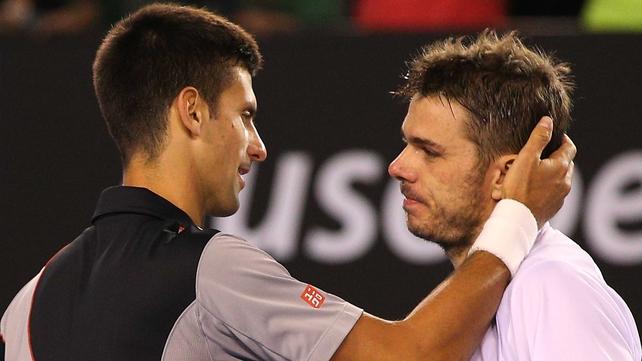 Novak Djokovic offers congratulations to the victorious Stanislas Wawrinka after an epic five-set battle