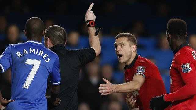 Nemanja Vidic getting his marching orders from referee Phil Dowd at Stamford Bridge