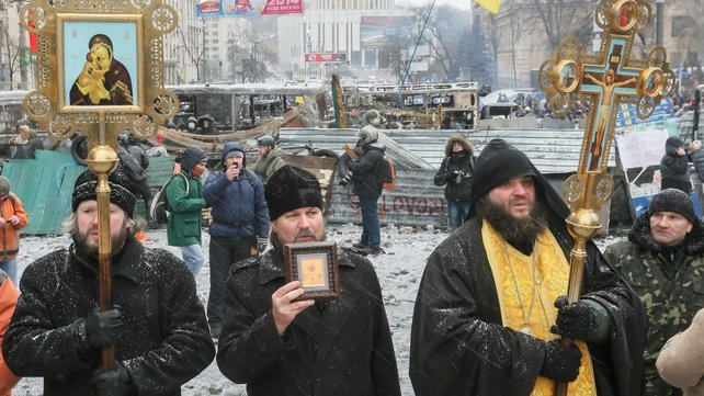 Orthodox church members stood between protesters until police