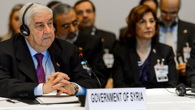 Syrian Foreign Minister Walid Muallem (L) and his delegation at the peace talks