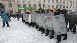 Protesters protected themselves with shields  (Pic: EPA)