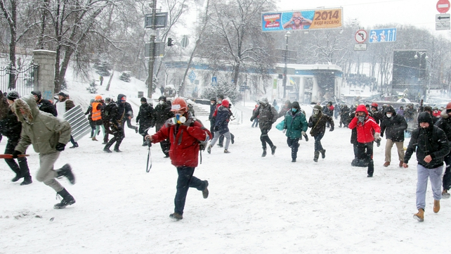 People run away from riot police during today's protests