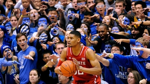 Opposition fans taunt Kyle Washington of the North Carolina State Wolfpack against the Duke Blue Devils in North Carolina