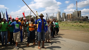 Striking miners near Lonmin's platinum mine in Marikana