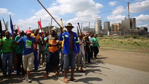 Striking miners near Lonmin's platinum mine in Marikana