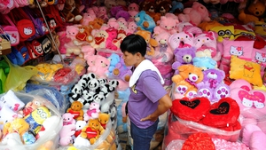 A toy vendor waits for costumers at the Divisoria market in the Philippine capital Manila
