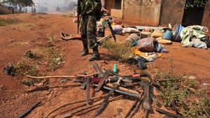 A soldier on a peacekeeping mission gathers knives in Central African Republic