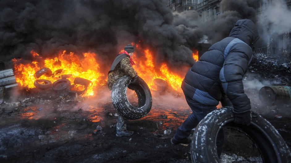 Protesters burn tires as they clash with riot police (Pic: EPA)