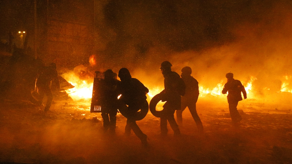 Protesters collect tires to keep the flaming barricade going (Pic: EPA)