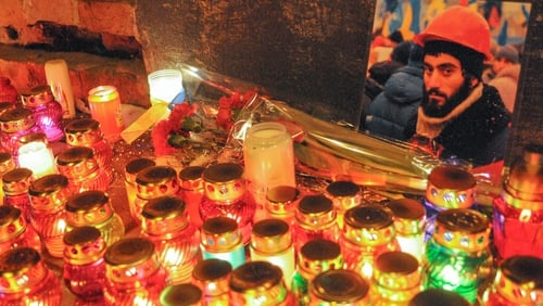 Candles at a shrine in memory of Sergey Nigoyan reportedly shot dead during protests (Pic: EPA)