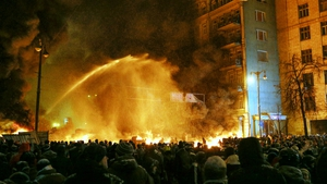 Police use water cannon to try to put out a fire of burning tires (Pic: EPA)