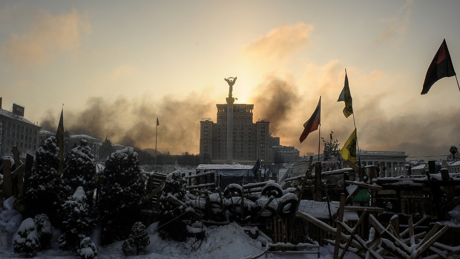 Sunrise above a barricade at the anti-government camp on Independence Square (Pic: EPA)