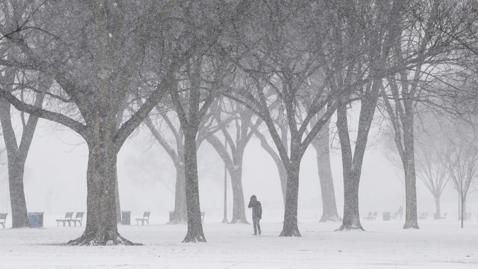 Blowing snow begins to pile up along the National Mall in Washington DC