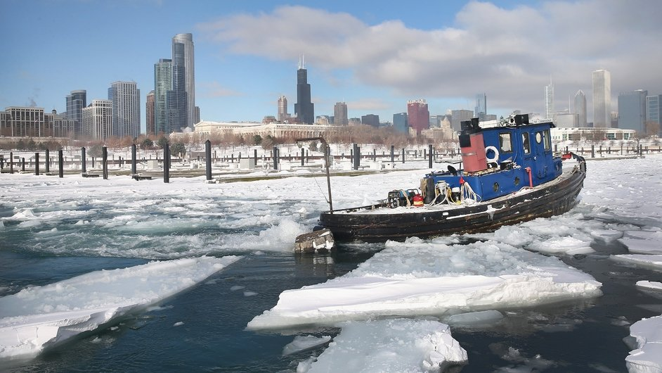 A tugboat breaks up ice in Burnham Harbor in Chicago, Illinois