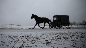 A horse pulls an Amish buggy during a snowfall in Mechanicsville, Maryland