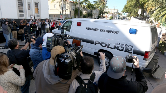 Police van carrying Justin Bieber leaves the Miami Beach Police station taking him to jail