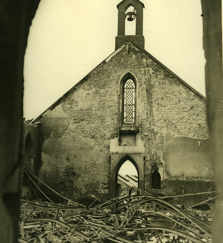 """Gutted interior of a church"" held by UCD Archives © WD Hogan. Digital image: © University College Dublin, published by UCD Digital Library. DOI: http://dx.doi.org/10.7925/drs1.ucdlib_30784"