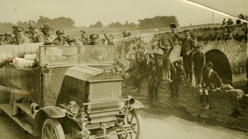 """A truck containing Irish Free State soldiers and a mattress, driven by a man in civilian dress"" held by UCD Archives. Digital image: © University College Dublin, published by UCD Digital Library. DOI: http://dx.doi.org/10.7925/drs1.ucdlib_30755"