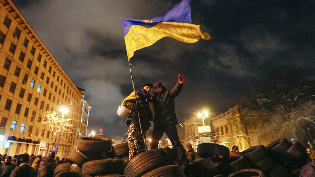 Protesters stand on top of a barricade in Kiev (Pic: EPA)
