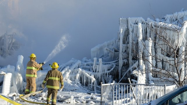 The wreckage of the building is covered in ice