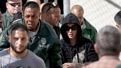 Justin Bieber leaving jail yesterday after posting bail.