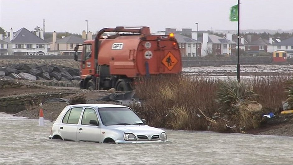 A car left stranded in flood water