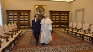 French President Francois Hollande speaks with Pope Francis during a private audience at the Vatican
