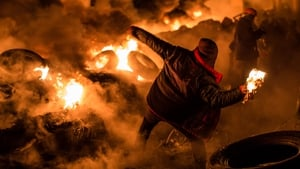 Masked men hurled Molotov cocktails and tyres into the burning flames