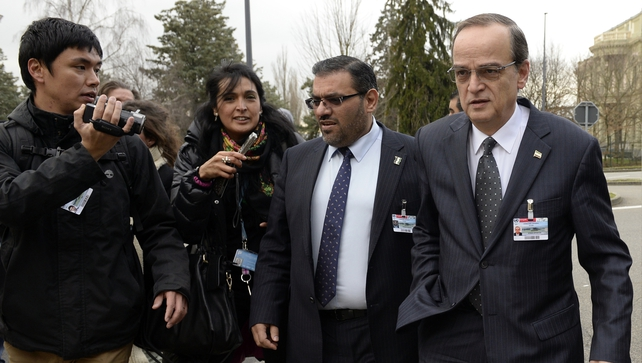 Syrian opposition chief negotiator Hadi al-Bahra (R) arrives to attend the Geneva talks