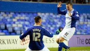 Lee Novak of Birmingham celebrates with teammate Paul Caddis after scoring the opening goal