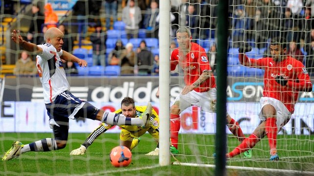 Cardiff City's Fraizer Campbell (R) scores during his side's encounter with Bolton