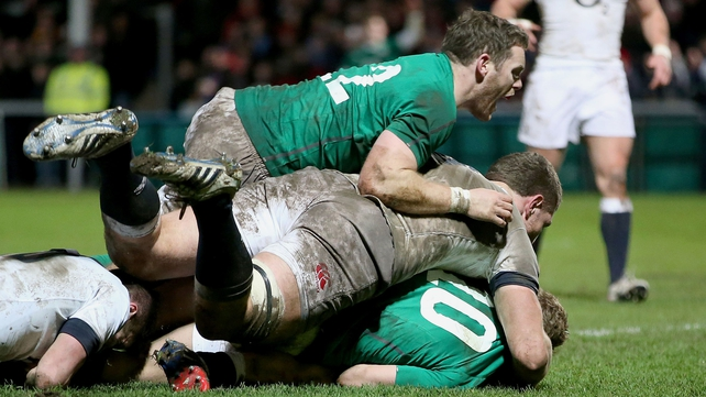 Ireland's Darren Cave celebrates as Ian Madigan goes over for a try
