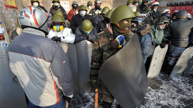 Protesters wear protective clothing at camp on Independence Square in Kiev
