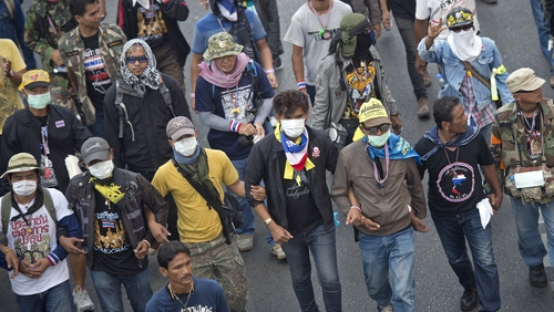 Violence erupted as demonstrators in Bangkok tried to block early voting for an election next week