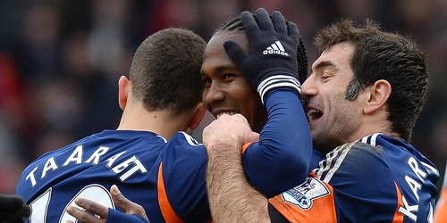 Hugo Rodallega (centre) is congratulated by his Fulham team-mates after his goal