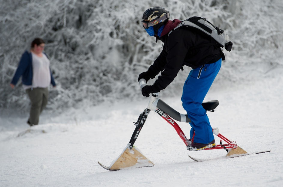 A man rides his snow bike in Schmitten, Germany