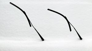 Two windscreen wipers stick out of the snow on a delivery van's windscreen near Bernbeuren, Germany